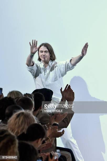 Fashion designer Alex Mullins walks the runway at the Alex Mullins Spring/Summer 2019 fashion show during London Fashion Week Men's June 2018 on June...