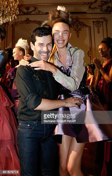 Fashion designer Alexis Mabille and a model attend the Alexis Mabille show as part of Paris Fashion Week - Haute Couture Fall/Winter 2014-2015 on...