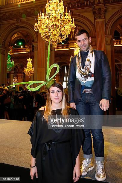 Fashion designer Alexis Mabille and his Catherinette attend Sainte-Catherine Celebration at Mairie de Paris on November 25, 2013 in Paris, France.