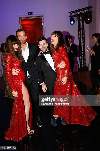Fashion designer Alexis Mabille dancing between les Brigittes Sylvie Hoarau and Aurelie Saada attend the 'Chambre Syndicale de la Haute Couture'...