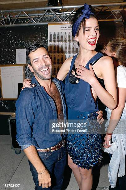 Fashion Designer Alexis Mabille with his model backstage after his show as part of the Paris Fashion Week Womenswear Spring/Summer 2014 at Docks en...