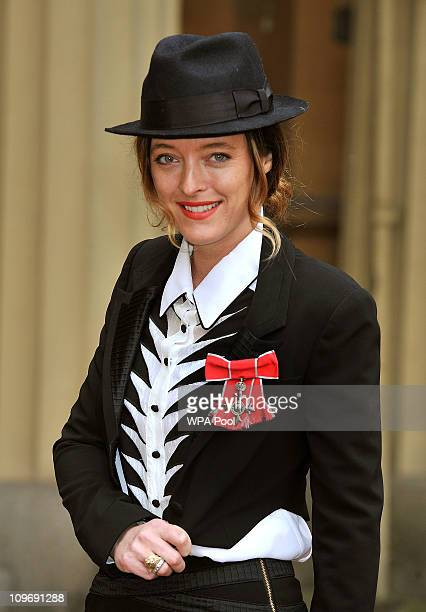 Fashion designer Alice Temperley wears her MBE after it was presented to her by Queen Elizabeth II during the investiture ceremony at Buckingham...