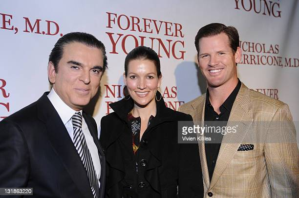 Fashion designer Amir a guest and football player Cade McNown attend Fashion Designer Amir Presents Dr Perricone's Forever Young Book Launch Party at...
