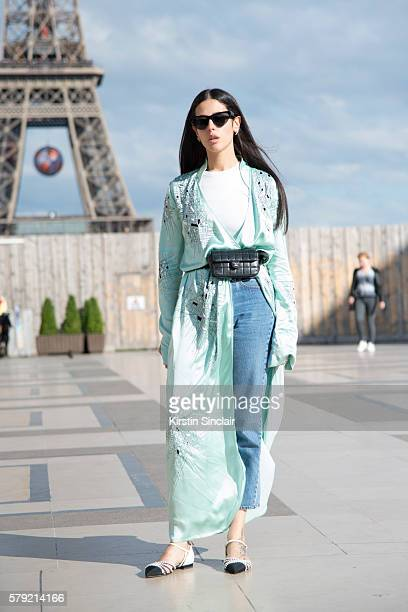 Fashion designer and blogger Gilda Ambrosio wears an Attico Kimono and Chanel bag and shoes on day 3 of Paris Haute Couture Fashion Week...