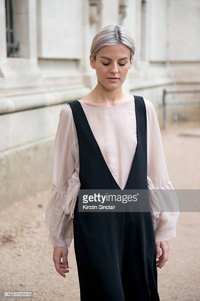 Fashion Designer and Blogger Maria Ilic wears an H and M shirt and Zara dungarees on day 8 during Paris Fashion Week Spring/Summer 2016/17 on October...