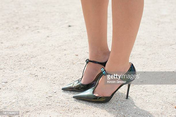 Fashion Designer and blogger Peony Lim wears Jimmy Choo shoes on day 5 of Paris Fashion Week Spring/Summer 2014, Paris September 28, 2013 in Paris,...