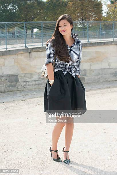 Fashion Designer and blogger Peony Lim wears Thomas Pink shirt, Golden Goose skirt and Jimmy Choo bag and shoes on day 5 of Paris Fashion Week...