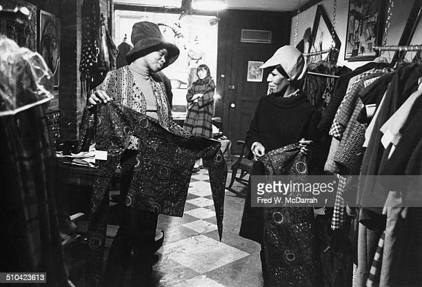 Fashion designer and boutique owner Khadejha with a customer in her shop at 5 St Marks Place New York New York February 18 1966