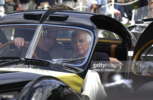 Fashion designer and car aficionado Ralph Lauren right sits in his 1938 Bugatti Type 57SC Atlantic vintage automobile winner best of show in 1990 at...