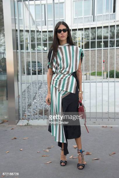 Fashion designer and co founder of Attico Gilda Ambrosio wears a Loewe top skirt and bag Le Specs sunglasses day 4 of Paris Womens Fashion Week...