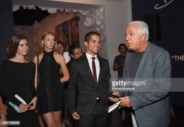 Fashion designer and cofounder of Guess Inc Paul Marciano and Gregoria Campos at GUESS Celebrates 35 Years with Opening of Exhibition at the FIDM...