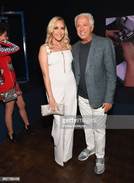 Fashion designer and cofounder of Guess Inc Paul Marciano and singersongwriter Eden xo at GUESS Celebrates 35 Years with Opening of Exhibition at the...