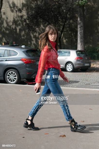Fashion designer and founder of fashion label Anna K Anna Karenina wears an Anna K blouse and jeans Marc Jacobs bag and Balenciaga shoes day 5 of...