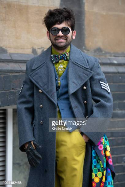 Fashion designer and founder of House of Gharats Dr Pretam Gharat wears a house of Gharats scarf and bow tie, Cos trousers, Thom Browne sunglasses...