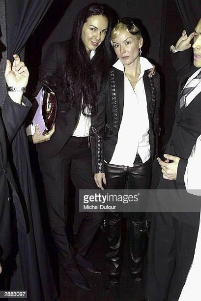 Fashion Designer and Mick Jagger's girlfriend L'Wren Scott poses with Daphnee Guiness at Christian Dior's Haute Couture Spring/Summer 2004 show on...