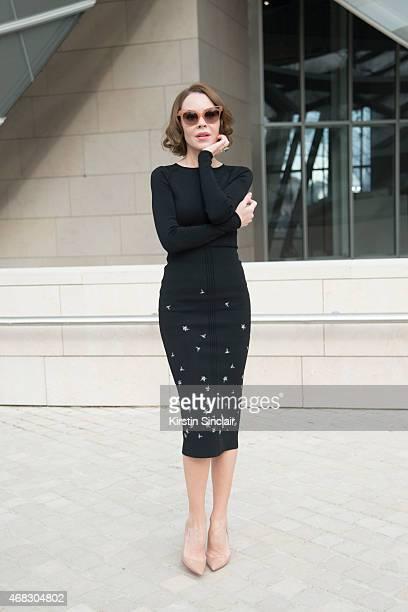 Fashion Designer and Photographer Ulyana Sergeenko wears a Ulyana Sergeenko dress Christian Louboutin shoes and Sonia Rykiel sunglasses on day 9 of...