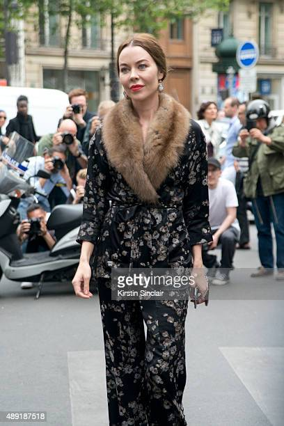 Fashion designer and Photographer Ulyana Sergeenko wears a Ulyana Sergeenko suit on day 4 of Paris Fashion Week Haute Couture Autumn/Winter 2015 on...
