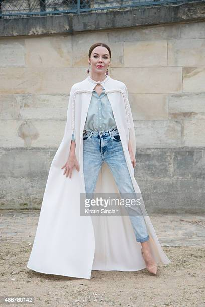 Fashion designer and photographer Ulyana Sergeenko wears Christian Louboutin shoes and her own design cape on day 8 of Paris Collections Women on...