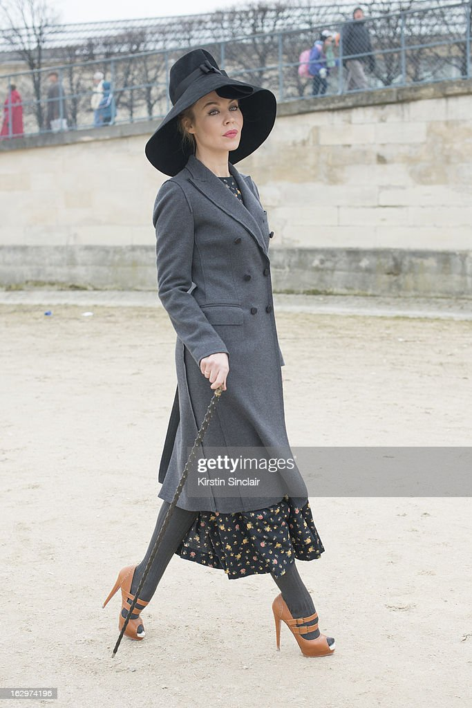 Fashion designer and photographer Ulyana Serjeenko wears a Dolce and Gabbana coat, a hat from Russia, Christian Louboutin shoes and her own design dress on day 2 of Paris Womens Fashion Week Autumn/Winter 2013 on March 1, 2013 in Paris, France.