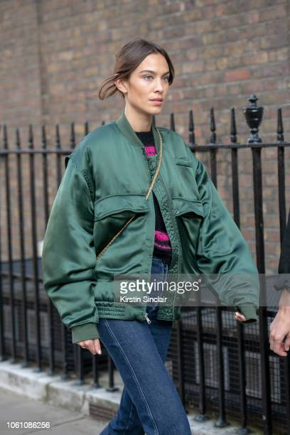 Fashion designer and Tv presenter Alexa Chung wears a Katherine Hamnett jacket blue jeans during London Fashion Week September 2018 on September 16...