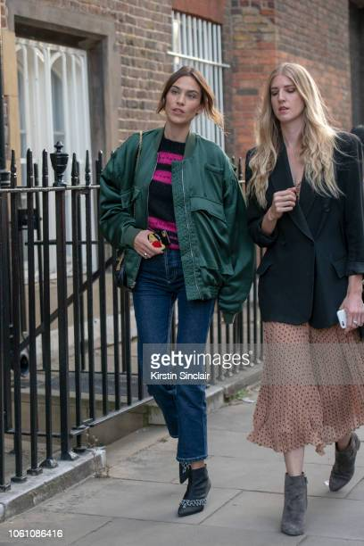 Fashion designer and Tv presenter Alexa Chung wears a Katherine Hamnett jacket blue jeans and Erdem boots during London Fashion Week September 2018...