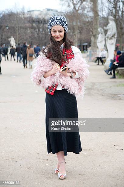 Fashion Designer and writer Natalia Alaverdian wears a Stella McCartney hat and shoes Balenciaga shirt Zara skirt and AWAKE scarf and vest on day 5...