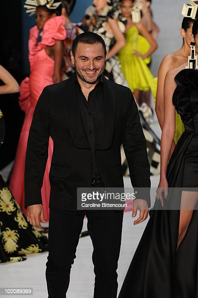 Fashion designer Andre Lima greets the audience at the end of his fashion show during the sixth day of the Sao Paulo Fashion Week Summer 2011 at the...