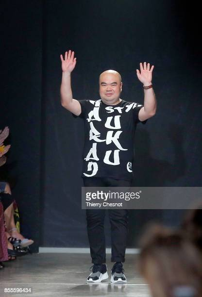Fashion designer Andrew GN ackowledeges the audience at the end of the Andrew GN show as part of the Paris Fashion Week Womenswear Spring/Summer 2018...
