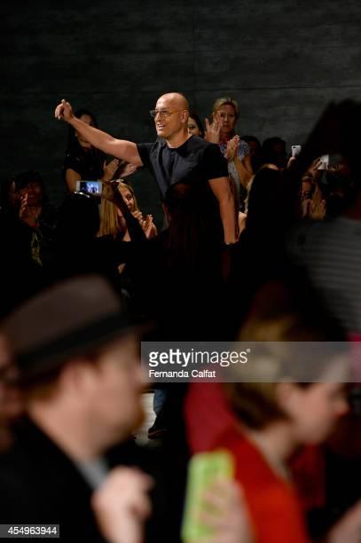 Fashion designer Angel Sanchez walks the runway at the Angel Sanchez fashion show during Mercedes-Benz Fashion Week Spring 2015 at The Pavilion at...