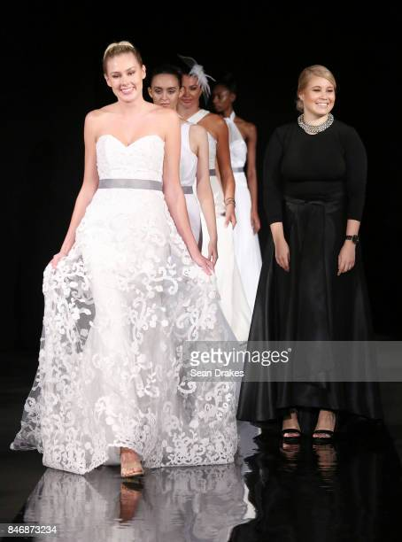 Fashion designer Angie Polanco of the Dominican Republic poses with models in the Fashion Designers of Latin America collection shows during New York...