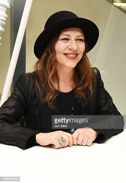 Fashion designer Ann Demeulemeester attends 'Ann Demeulemeester Photobook' autographing event at Dover Street Market Ginza on November 21 2014 in...