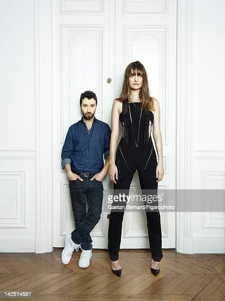 Fashion designer Anthony Vaccarello poses with model/music producer Caroline de Maigret for Madame Figaro on January 19 2012 in Paris France...
