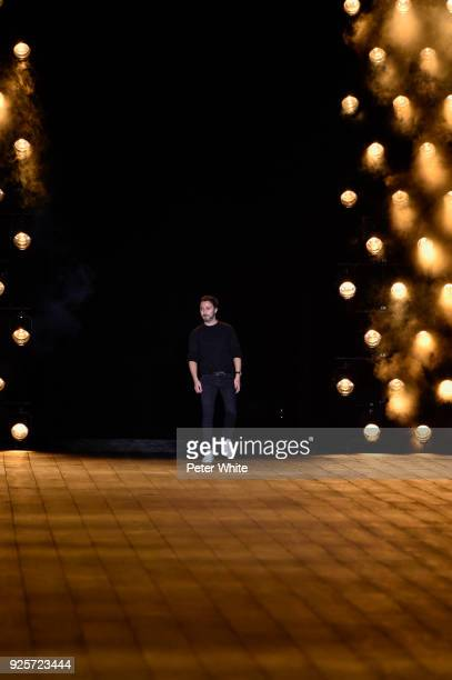 Fashion designer Anthony Vaccarello walks the runway after the Saint Laurent show as part of the Paris Fashion Week Womenswear Fall/Winter 2018/2019...