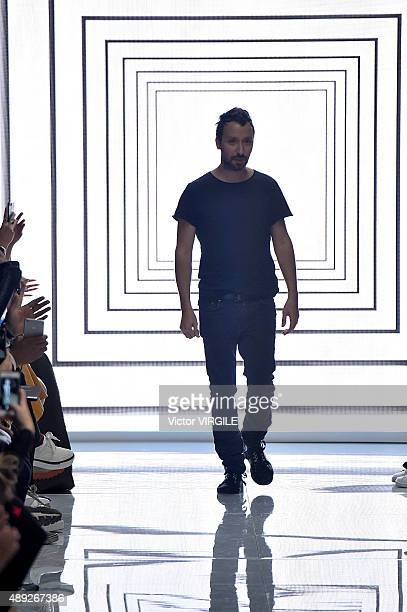 Fashion designer Anthony Vaccarello walks the runway at the Versus Ready to Wear show during London Fashion Week Spring/Summer 2016 on September 19...