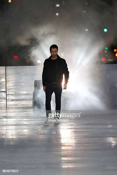 Fashion designer Anthony Vaccarello walks the runway during the Saint Laurent Ready to Wear Spring/Summer 2018 fashion show as part of the Paris...