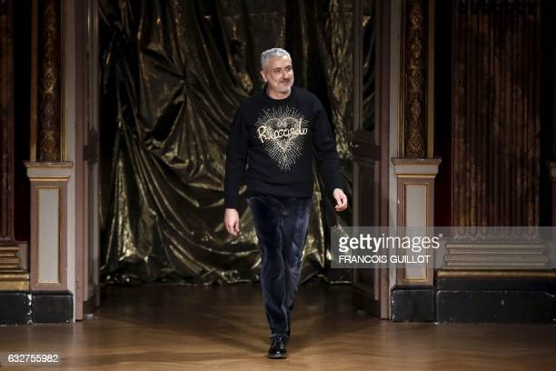 Fashion designer Antonio Grimaldi acknowledges the audience at the end of the 2017 spring/summer Haute Couture collection on January 26 2017 in Paris...