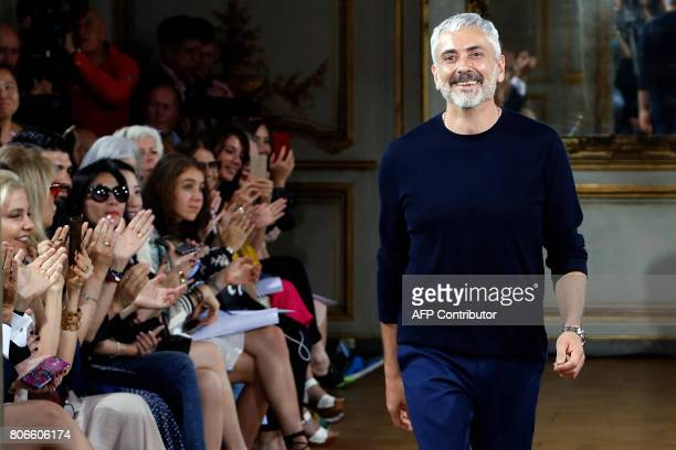 Fashion designer Antonio Grimaldi acknowledges the audience at the end of his 2017 fall/winter Haute Couture collection in Paris on July 3 2017 / AFP...