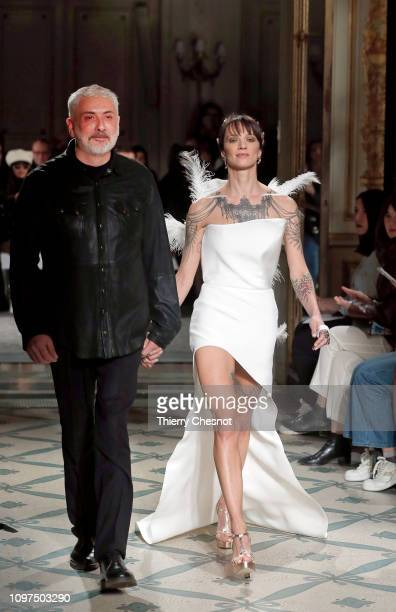 Fashion designer Antonio Grimaldi and Italian actress Asia Argento acknowledge the audience at the end of the Antonio Grimaldi Spring Summer 2019...