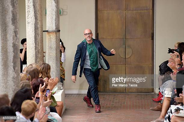 Fashion designer Antonio Marras acknowledges the applause of the audience after the I'M Isola Marras show as part of Milan Fashion Week Womenswear...