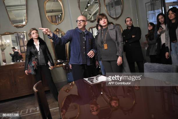 Fashion designer Antonio Marras shows his atelier to guests during the open days 'Apritimoda' in Milan on October 21 2017 / AFP PHOTO / MARCO...