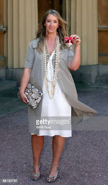 Fashion designer Anya Hindmarch poses with the MBE she received earlier from Queen Elizabeth II during investitures at Buckingham Palace on June 2...
