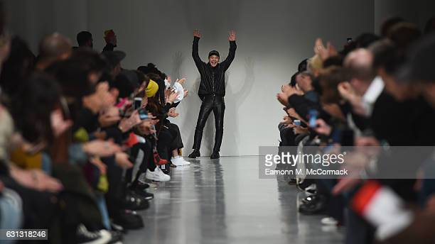 Fashion designer Arashi Yanagawa on the runway after the John Lawrence Sullivan show during London Fashion Week Men's January 2017 collections at BFC...