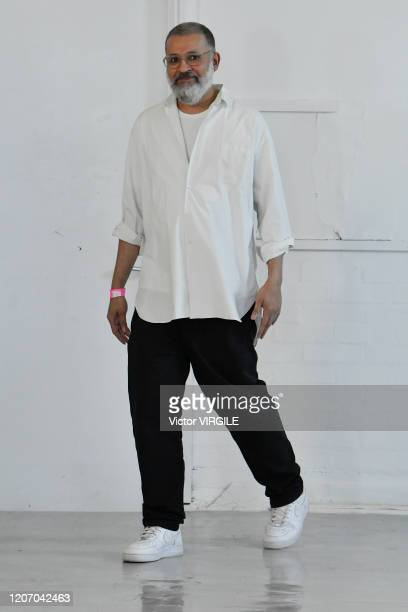Fashion designer Ashish Gupta walks the runway at the Ashish Ready to Wear Fall/Winter 20202021 fashion show during London Fashion Week on February...
