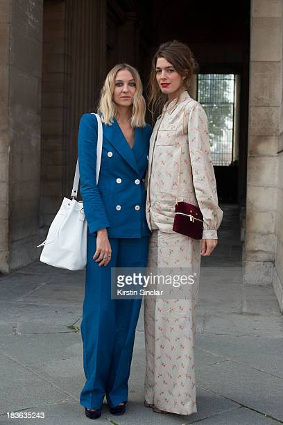 Fashion designer at T180 Luisa Orsini wears a Louis Vuitton suit Oz shoes and a T180 bag and Fashion designer at T180 Antonine Peduzzi wearing a...