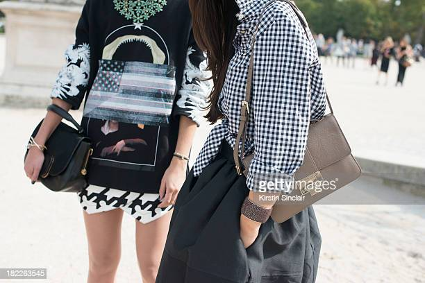 Fashion Designer at The Kooples Anne- Catherine Frey wears Givenchy top, Balenciaga shorts,Todds bag and Fashion Designer with fashion blogger Peony...