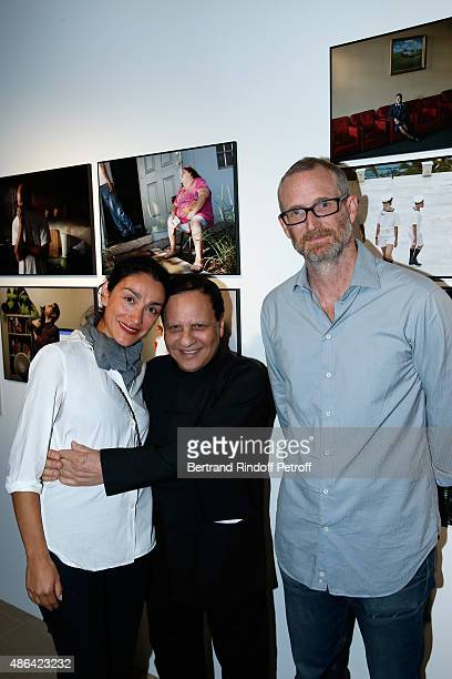 Fashion Designer Azzedine Alaia standing between Contemporary Artist Mike Bouchet and his companion Galerist Parisa Kind attend the 'World Press...