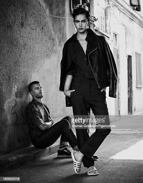 107252004 Fashion designer Barnabé Hardy is photographed with model for Madame Figaro on June 26 2013 in Paris France On model Shirt pants and jacket...