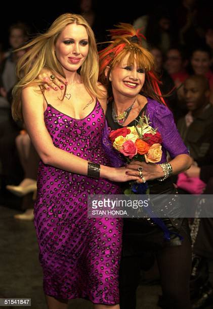 Fashion designer Betsey Johnson and daughter Lulu walk down runway after Johnson's show 08 February in New York The show is part of the Fashion Week...