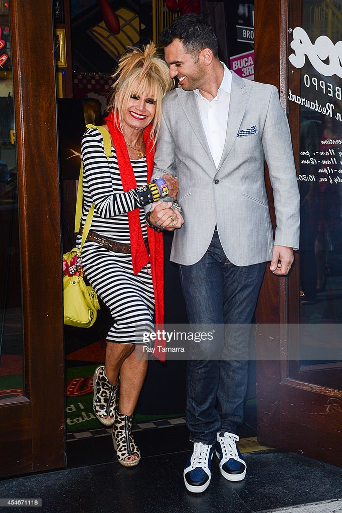 Fashion designer Betsey Johnson (L) and professional dancer Tony Dovolani leave Planet Hollywood Times Square on September 4, 2014 in New York City.