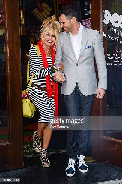 Fashion designer Betsey Johnson and professional dancer Tony Dovolani leave Planet Hollywood Times Square on September 4 2014 in New York City